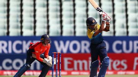 Ravindu Rashantha of Sri Lanka hits the ball towards the boundary, as Jordan Cox of England looks on during the ICC U19 Cricket World Cup Plate Final match between Sri Lanka and England at Willowmoore Park on February 03, 2020 in Benoni, South Africa.