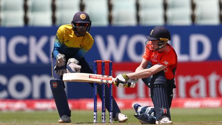 Daniel Mousley of England sweeps the ball towards the boundary, as Kamil Mishara of Sri Lanka looks on during the ICC U19 Cricket World Cup Plate Final match between Sri Lanka and England at Willowmoore Park on February 03, 2020 in Benoni, South Africa.