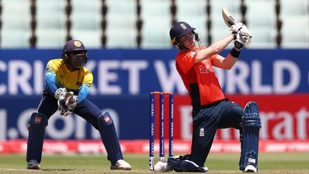 Joseph Evison of England hits the ball towards the boundary, as Kamil Mishara of Sri Lanka looks on during the ICC U19 Cricket World Cup Plate Final match between Sri Lanka and England at Willowmoore Park on February 03, 2020 in Benoni, South Africa.