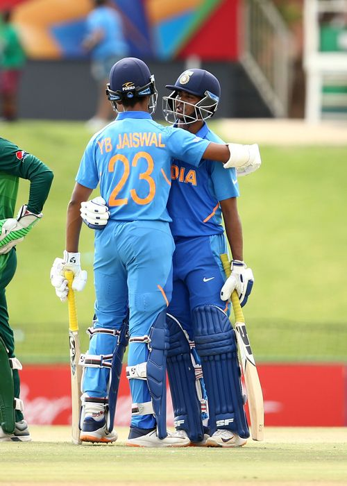 Yashasvi Jaiswal of India and Divyaansh Saxena of India celebrates a century partnership during the ICC U19 Cricket World Cup Super League Semi-Final match between India and Pakistan at JB Marks Oval on February 04, 2020 in Potchefstroom, South Africa.