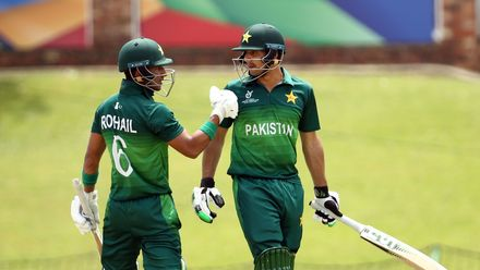 Rohail Nazir and Haider Ali of Pakistan celebrate a half century partnership during the ICC U19 Cricket World Cup Super League Semi-Final match between India and Pakistan at JB Marks Oval on February 04, 2020 in Potchefstroom, South Africa.