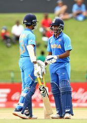 Yashasvi Jaiswal of India and Divyaansh Saxena of India celebrates a half century partnership during the ICC U19 Cricket World Cup Super League Semi-Final match between India and Pakistan at JB Marks Oval on February 04, 2020 in Potchefstroom.