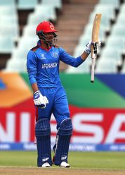 Ibrahim Zadran of Afghanistan celebrates his half century during the ICC U19 Cricket World Cup 7th Place Play-Off match between South Africa and Afghanistan at Willowmoore Park on February 05, 2020 in Benoni, South Africa.