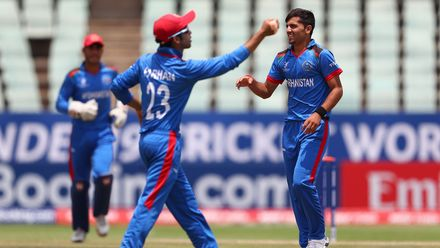 Fazalhaq Farooqi of Afghanistan celebrates the wicket of Mondli Khumalo of South Africa during the ICC U19 Cricket World Cup 7th Place Play-Off match between South Africa and Afghanistan at Willowmoore Park on February 05, 2020 in Benoni, South Africa.
