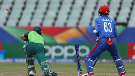 Luke Beaufort of South Africa is bowled by Shafiqullah Ghafari of Afghanistan during the ICC U19 Cricket World Cup 7th Place Play-Off match between South Africa and Afghanistan at Willowmoore Park on February 05, 2020 in Benoni, South Africa.