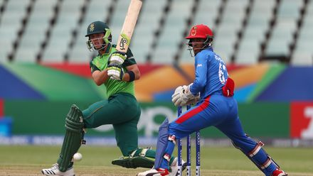 Luke Beaufort of South Africa sweeps the ball towards the boundary, as Mohammad Ishaq Shirzad of Afghanistan looks on during the ICC U19 Cricket World Cup 7th Place Play-Off match between South Africa and Afghanistan on February 05, 2020.