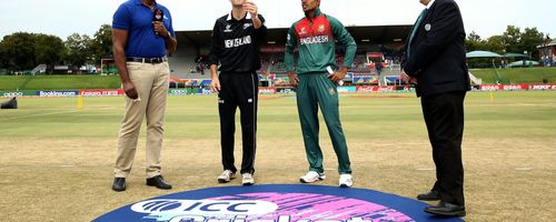Jesse Tashkoff of New Zealand tosses the coin with Mohammad Akbar Ali of Bangladesh looking on during the ICC U19 Cricket World Cup Super League Semi-Final match between New Zealand and Bangladesh at JB Marks Oval on February 06, 2020.