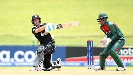 Beckham Wheeler-Greenall of New Zealand bats with Mohammad Akbar Ali of Bangladesh keeping wicket during the ICC U19 Cricket World Cup Super League Semi-Final match between New Zealand and Bangladesh at JB Marks Oval on February 06, 2020.