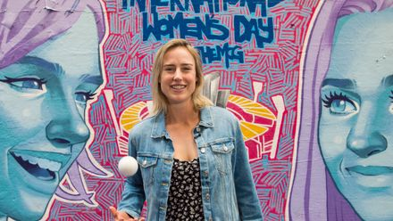Ellyse Perry in front of mural