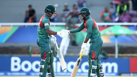 Mahmudul Hasan Joy of Bangladesh is congratulated on his half century by batting partner Shahadat Hossain of Bangladesh during the ICC U19 Cricket World Cup Super League Semi-Final match between New Zealand and Bangladesh on February 06, 2020.