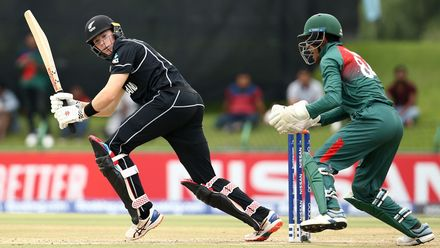 Fergus Lellman of New Zealand bats with Mohammad Akbar Ali of Bangladesh keeping wicket during the ICC U19 Cricket World Cup Super League Semi-Final match between New Zealand and Bangladesh at JB Marks Oval on February 06, 2020.