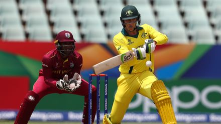 Liam Scott of Australia hits the ball towards the boundary, as Leonardo Julien of West Indies looks on during the ICC U19 Cricket World Cup 5th Place Play-Off match between West Indies and Australia at Willowmoore Park on February 07, 2020 in Benoni.