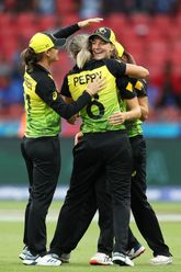 Jess Jonassen and Ellyse Perry of Australia congratulate Annabel Sutherland of Australia after taking the catch to dismiss Shafali Verma of Indiaduring the ICC Women's T20 Cricket World Cup match between Australia and India at Sydney on February 21, 2020.