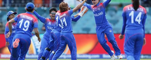 Wongpaka Liengprasert of Thailand celebrates with team mates after taking a catch to dismiss Danielle Wyatt of England during the ICC Women's T20 Cricket World Cup match between England and Thailand at Manuka Oval on February 26, 2020.