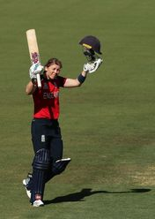 Heather Knight of England celebrates and acknowledges the crowd after scoring a century during the ICC Women's T20 Cricket World Cup match between England and Thailand at Manuka Oval on February 26, 2020 in Canberra, Australia.