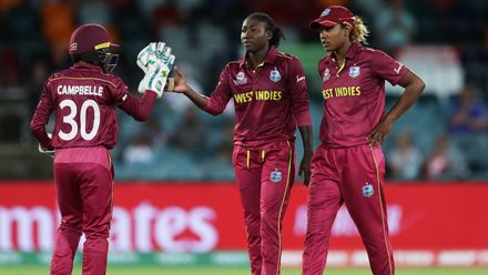 Stafanie Taylor of the West Indies celebrates with team mates after taking the wicket of Javeria Khan of Pakistan during the ICC Women's T20 Cricket World Cup match between the West Indies and Pakistan at Manuka Oval on February 26, 2020.