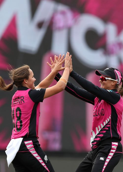 Amelia Kerr of New Zealand (L) and Hayley Jensen of New Zealand celebrate the dismissal of Shafali Verma of India during the ICC Women's T20 Cricket World Cup match between India and New Zealand at Junction Oval on February 27, 2020.