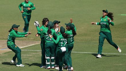 Diana Baig of Pakistan celebrates with teammates after dismissing Dane Van Niekerk of South Africa.