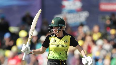 Beth Mooney of Australia celebrates and acknowledges the crowd after hitting a half century during the ICC Women's T20 Cricket World Cup match between Australia and New Zealand at Junction Oval on March 02, 2020 in Melbourne, Australia.