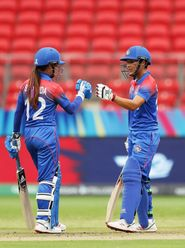 Natthakan Chantham of Thailand (R) celebrates scoring a half century with Chanida Sutthiruang (L) during the ICC Women's T20 Cricket World Cup match between Pakistan and Thailand at Sydney Showground Stadium on March 03, 2020 in Sydney, Australia.