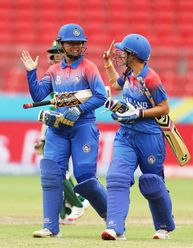 Onnicha Kamchomphu (L) and Nannapat Koncharoenkai (R) of Thailand celebrate as they walk off after their innings during the ICC Women's T20 Cricket World Cup match between Pakistan and Thailand at Sydney Showground Stadium on March 03, 2020.