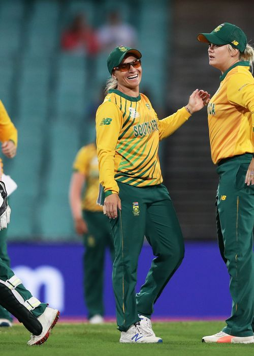 Mignon du Preez (L) and Dane Van Niekerk (R) of South Africa celebrate the wicket of Alyssa Healy of Australia during the ICC Women's T20 Cricket World Cup Semi Final match between Australia and South Africa at Sydney Cricket Ground on March 05, 2020.