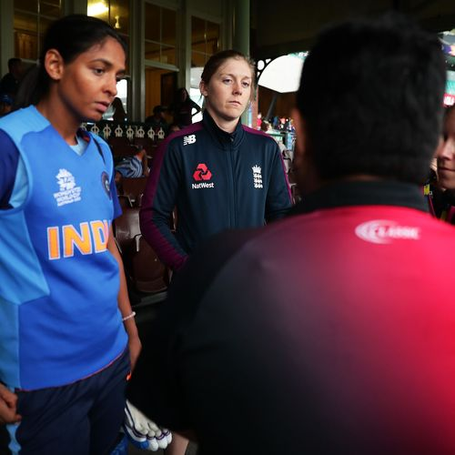 Captains Harmanpreet Kaur of India and Heather Knight of England speak to umpires before play was abandoned due to rain during the ICC Women's T20 Cricket World Cup Semi Final match between India and England on March 05, 2020.