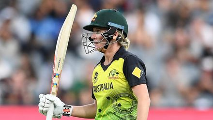 Beth Mooney of Australia celebrates reaching 50 runs during the ICC Women's T20 Cricket World Cup Final match between India and Australia at the Melbourne Cricket Ground on March 08, 2020 in Melbourne, Australia.