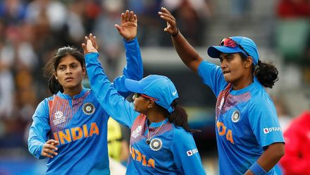 Radha Yadav of India (L) celebrates after dismissing Alyssa Healy of Australia during the ICC Women's T20 Cricket World Cup Final match between India and Australia at the Melbourne Cricket Ground on March 08, 2020 in Melbourne, Australia.