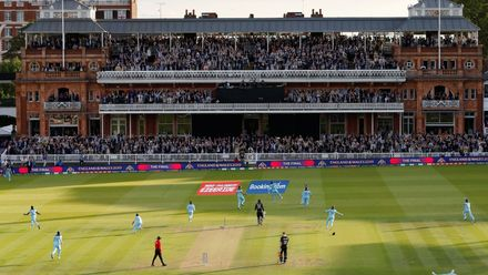 Shortlist - Andrew Boyers: England players, fans and MCC Members in the Pavilion celebrate England winning the ICC Men's Cricket World Cup Final at Lord's