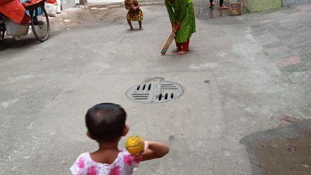 Girls play a game of street cricket. Location: Mirpur, Dhaka, Bangladesh. Photo credit: Rabiul Awal