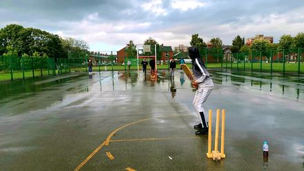 Cricket on basketball courts makes for the perfect 'net' practice! Location: Manchester, England. Photo credit: Ali Murtaza