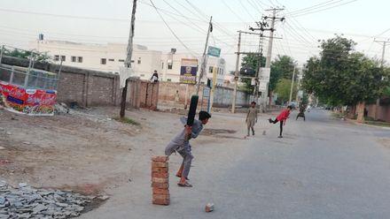 Cricket on the streets. Location: Multan, Pakistan. Credit: Muhammad Waqar Ishaq