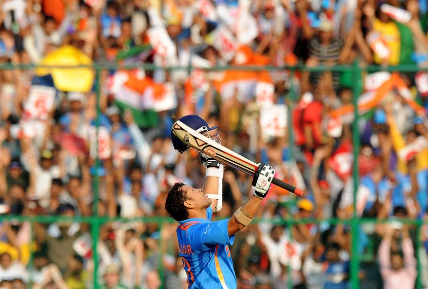 Sachin Tendulkar celebrates his century against England.