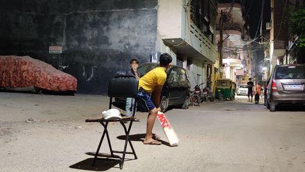 Street cricket under the lights. Location: Delhi, India. Photo credit: Shaikh Fatehuddin