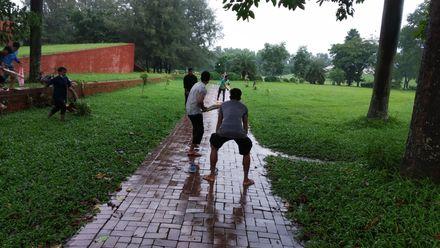 Play carries on in wet conditions. Photo credit: Pronab Nokrek. Location: Dhaka, Bangladesh