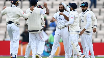 The Indian team celebrates the fall of a wicket after fast bowler Mohammad Shami takes a New Zealand wicket on the fifth day of the ICC World Test Championship Final in Southampton. Picture credit @ICC