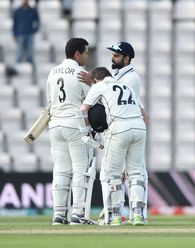 India captain Virat Kohli congratulates Kane Williamson and Ross Taylor after the pair guided New Zealand to an eight-wicket win in the ICC World Test Championship Final in Southampton.