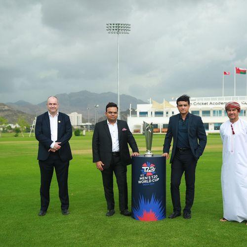ICC Acting CEO Geoff Allardice, BCCI Secretary Jai Shah, BCCI President Sourav Ganguly and Oman Cricket Chairman Pankaj Khimji with the ICC Men's T20 World Cup trophy