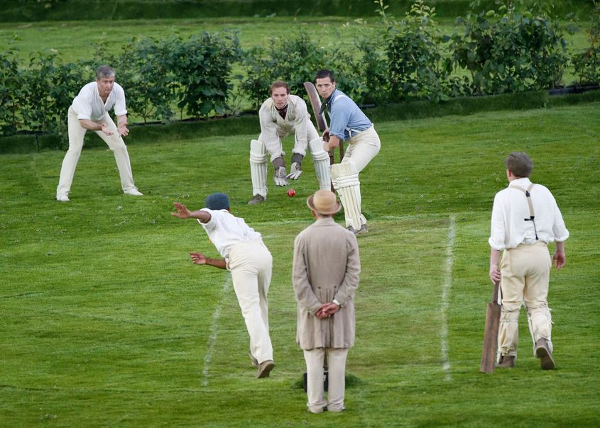 Artists playing cricket during the opening ceremony of London 2012