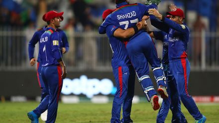 Shahzad with an acrobatic effort behind the stumps
